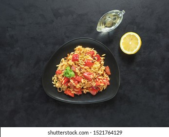 Roasted pepper and chorizo orzo salad combines red peppers, red onion, chorizo and cherry tomatoes with orzo pasta.