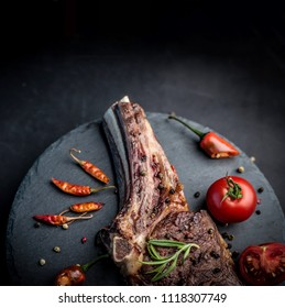 Roasted piece of beef with vegetables. Delicious beef steak with tomatoes, rosemary and pepper