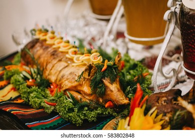 roasted pig on a bed of lettuce. buffet table
