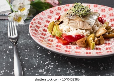 roasted Pike perch perch with vegetables and rice risotto. Close up, horizontal , selective focus. Dietary menu. Fish menu. Seafood. Concept of healthy food.