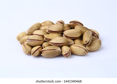 Roasted pistachio nuts in shell on white background