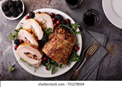 Roasted pork loin stuffed with apple and cranberry with spices