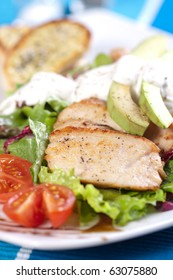 Roasted pork meat with fresh green salad