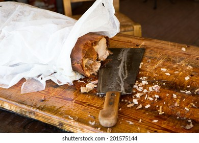 Roasted pork  on wooden table in store
