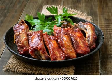 Roasted pork ribs in frying pan