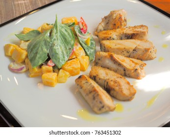 Roasted pork slices and salad.