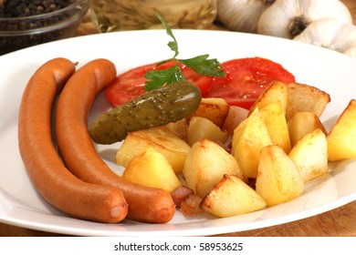 roasted potato with two home made sausages
