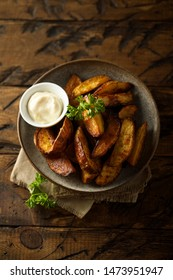 Roasted potato wedges with sauce