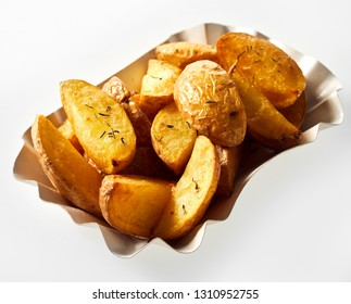 Roasted potato wedges in their jackets seasoned with rosemary and served in a dish as an appetizer or accompaniment to dinner