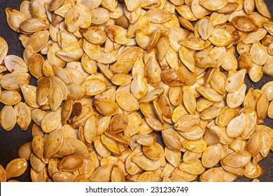 Roasted pumpkin seeds, on a stone plate