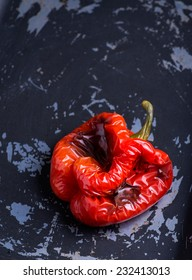 Roasted red pepper over dark background, selective focus, copyspace