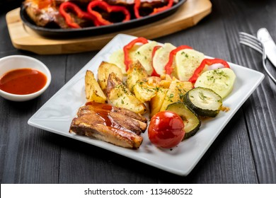 roasted ribs in chili sauce with vegetables