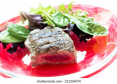 Roasted roastbeef with leaf lettuce on a plate