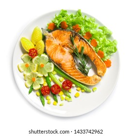 Roasted Salmon steak fusion food with asparagus,lemon, grill tomato and carved vegetables style top view