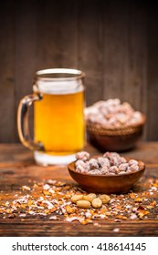 Roasted and salted peanuts and beer