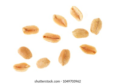 Roasted salted peanuts isolated on a white background, top view