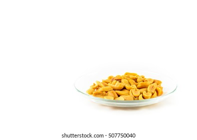 Roasted salted peanuts on plate isolated on a white background