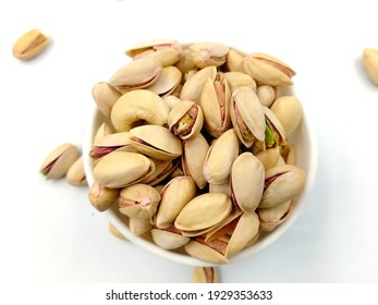 Roasted salted pistachio nuts in nutshell
