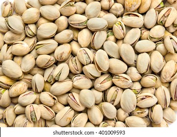 Roasted and salted pistachios in shell (texture, background)