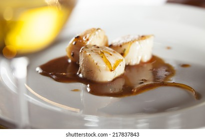 Roasted scallops with orange glaze and a hint of fennel paired with chenin blanc wine