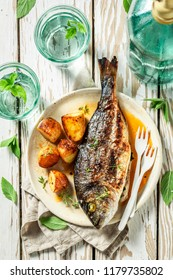 Roasted seabream and potatoes with cherry tomatoes and thyme