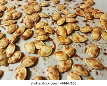 roasted seasoned pumpkin seeds on parchment paper
