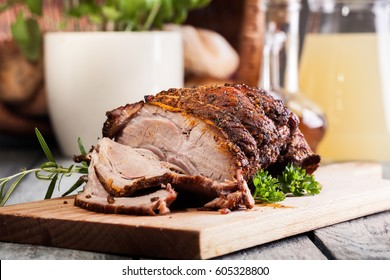 Roasted shoulder of pork on a cutting board