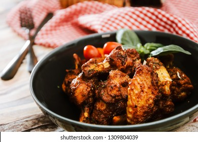 roasted sleeves chicken with potatoes and barbecue sauce