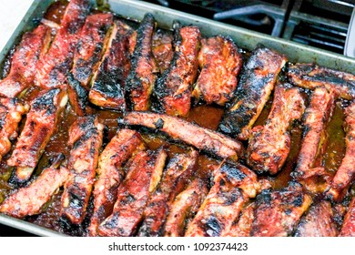 Roasted sliced barbecue pork ribs, with barbecue sauce