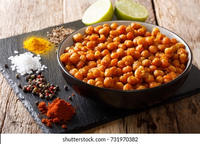 roasted spicy chickpeas with ingredients close-up on the table. horizontal