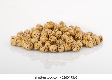 Roasted spicy chickpeas on white background
