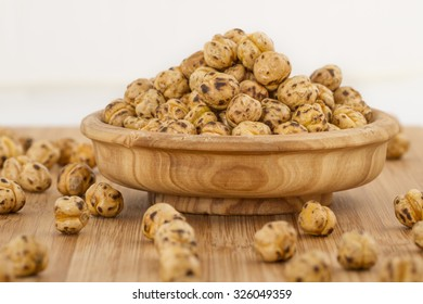 Roasted spicy chickpeas on wood bamboo