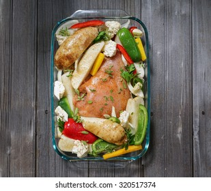 Roasted Spicy Turkey Breast with Vegetables Garnish/ oven ready/ wood background