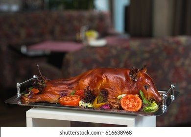 roasted suckling pig with vegetables. Brunch in a restaurant