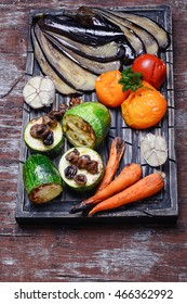 Roasted summer vegetables on the kitchen cutting board