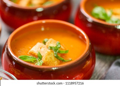 Roasted tomato soup with fresh basil and croutons.