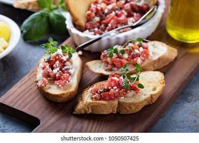 Roasted tomatoes bruschetta with feta and thyme