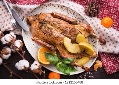 Roasted turkey with apple and orange on a christmas table. Thanksgiving day food background. top view