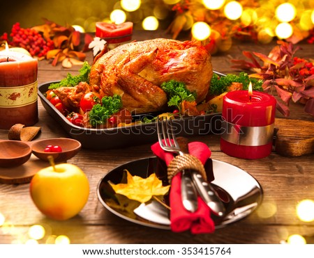 christmas dinner table served with turkey decorated with candles roasted