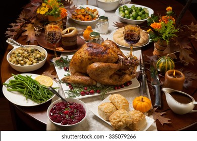 Superbe Roasted Turkey Garnished With Cranberries On A Rustic Style Table Decoraded  With Pumpkins, Gourds,