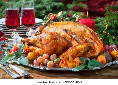 Roasted turkey on holiday Christmas table with candles