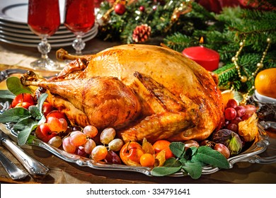 Roasted turkey on holiday table with candles