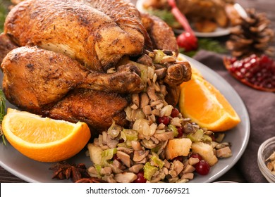 Roasted turkey with stuffing served on holiday table, closeup