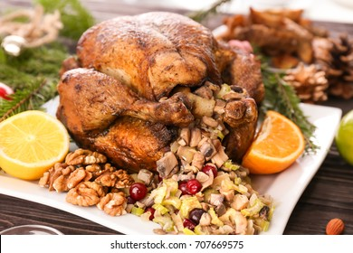 Roasted turkey with stuffing served on holiday table