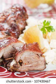 Roasted veal ribs with potato and cheese salad