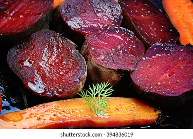 roasted vegetables beets carrots dark background selective focus toning rustic old style
