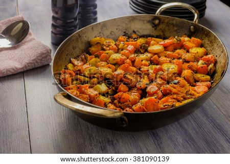 Roasted vegetables in a metal serving bowl
