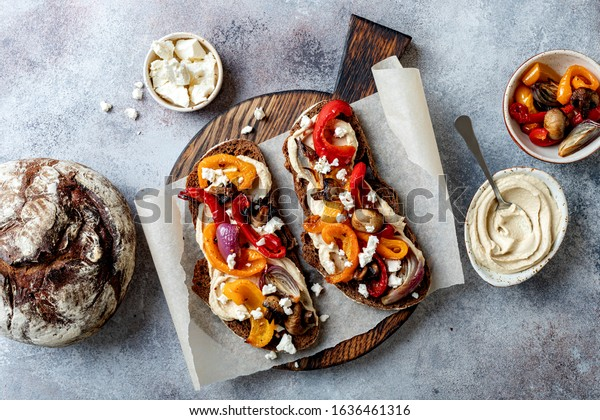 Roasted vegetables toast with hummus and feta cheese