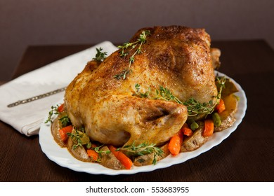 Roasted whole chicken with vegetables and thyme