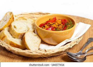Roasted Yellow and Red Bell Pepper Spread with bread.